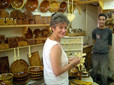 Deb Haylor McDowell with the spooncarver in Marakech ( didn't get his name).