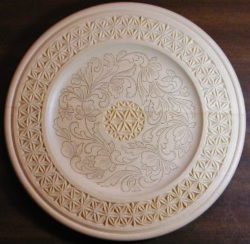 Chip carved and kolrosed plate by Judy Ritger